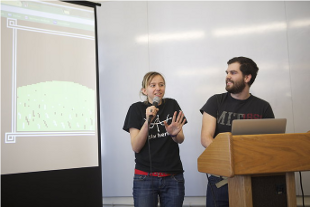 Michele with a stupid face and Shawn looking happy presenting our work at the designathon