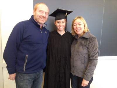Graduation photo with mom and dad